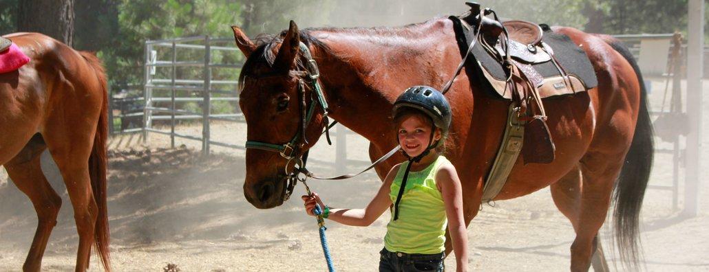 Ranch 17 - smiling little girl walking horse