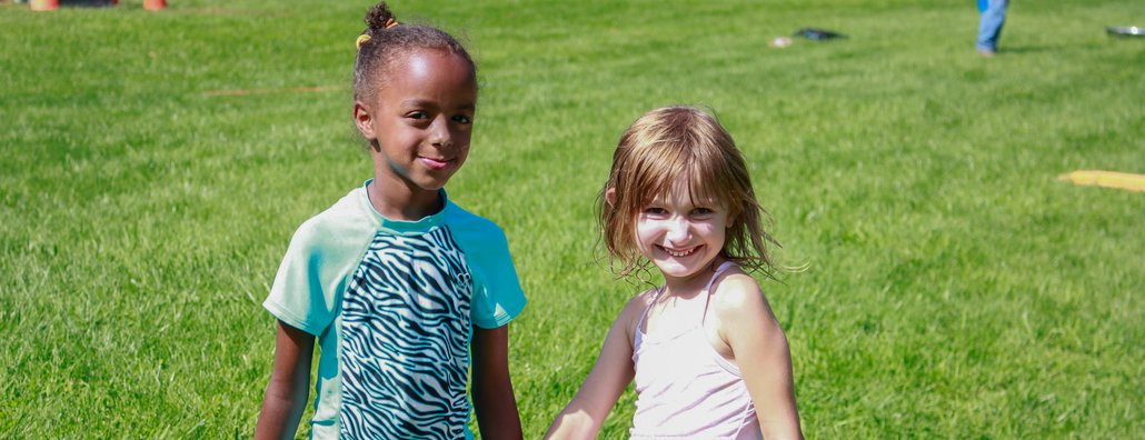 KC Day Camp - Two Girls in Grass
